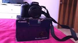 Canon power shot 60hs 60 veces aumento con cargador bateria y correa