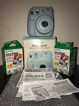 Fujifilm camara instax + 2 rollos de 20