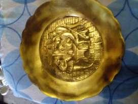 Platos de bronce labrado
