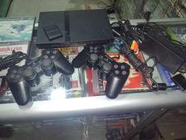Ps2 con controles y juegos