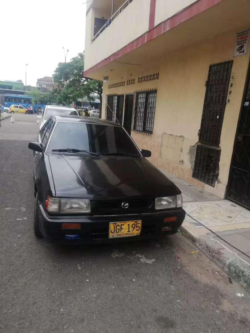 Cupe 323HS color negro 4 puertas 0