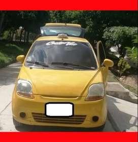 Se vende taxi spark mod 2013 perfecto estado.