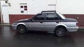 Mazda 323 en muy buen estado modelo 2004 precio negociable