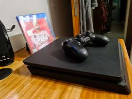 Vendo Ps4 slim 1tb con 1 joysticks original + Fifa 20