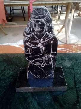 Imagen del Gaucgito Gil en marmol