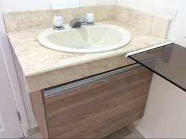 Lavamanos con mesón mármol y mueble funcional