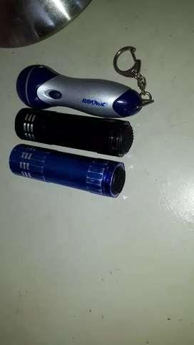 Linternas 2 de aluminio y una de plástico funcionando
