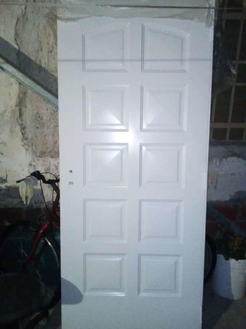 Puerta nueva a extrenar chapa doble inyectada marca nexo aberturas 0