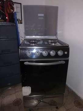 Espectacular Estufa con horno y encendido eléctrico