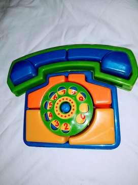 telefono didactico juego para 2 añ golpeado en su caja
