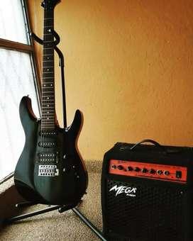 oferta guitarra electrica mas amplificador linea y estuche en 400 mil,
