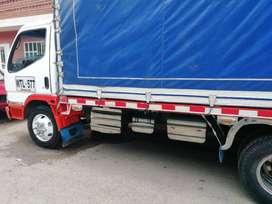 Camión turbo midsubishi Canter 2003 estacas tipo npr con trabajo también Nqr 2012 con carrocería 580 95 millones
