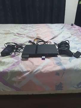 PlayStation 2 en perfecto estado con un control  un juego negociable 70.000 mil pesos