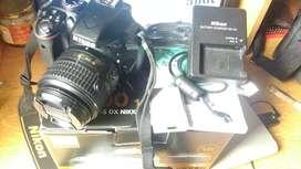 Necesito el efectivo camara profesional Nikon en caja como nuevo