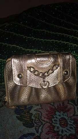 Billetera Isadora plateada poco uso !!