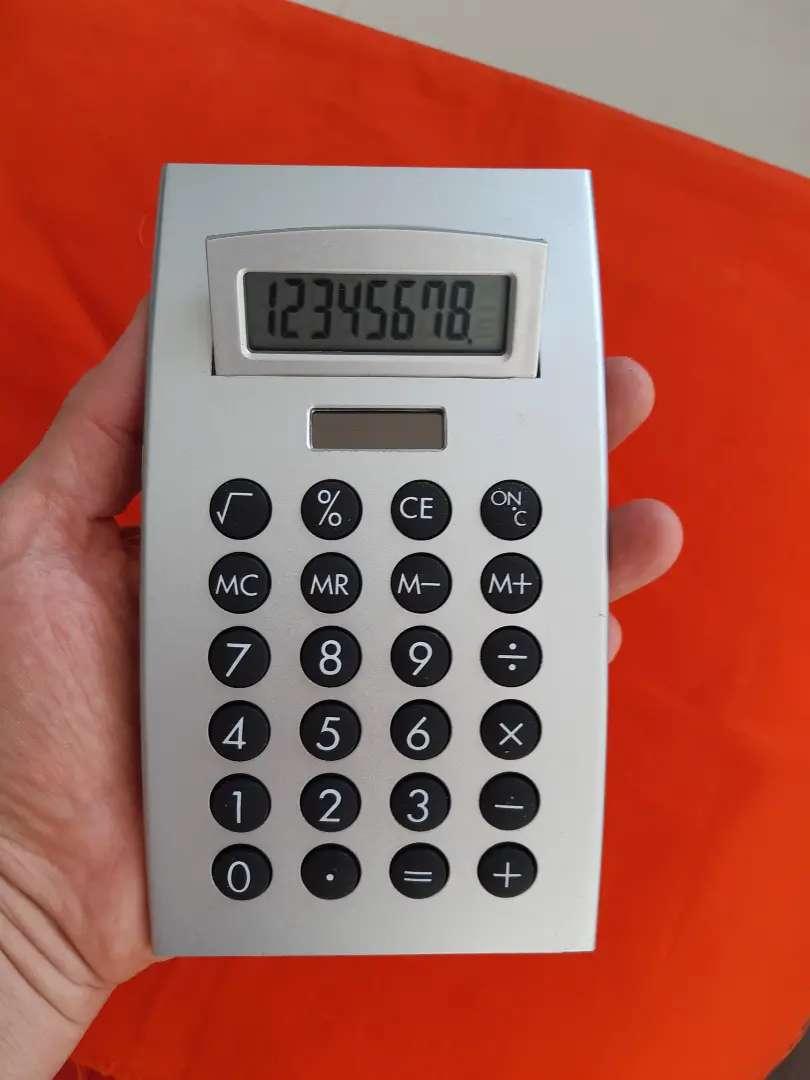 Calculadora sencilla para casa 8 dígitos color plateado mini solar 0