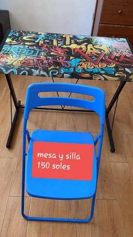 Mesa de metal y silla