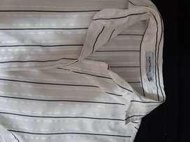 Camisa manga 3/4.