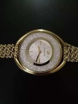Reloj swarovski de mujer impecable con caja y tiket