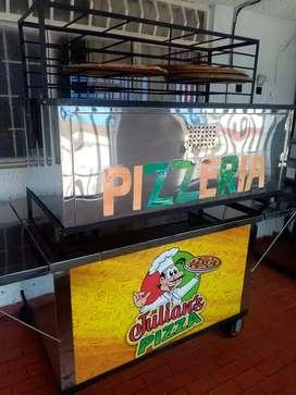 Carro de pizza si quieren con puesto y todo en el parq del barrio Girardot en todo el frente del mercantil