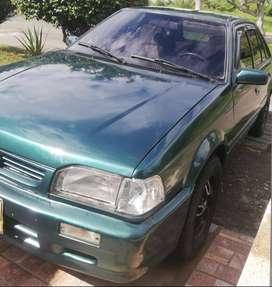 Se vende o se permuta hermoso Mazda 323 modelo 1999 con Papeles al día por camioneta en estaca económica