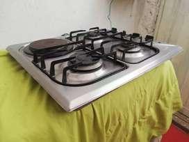 Estufa para empotrar marca haceb de 3 fogones a gas y uno electrico