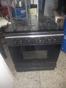 Vendo cocina grande para familias o para restaurante o casa finca cali con horno amplio y calentador gas encendido elec.