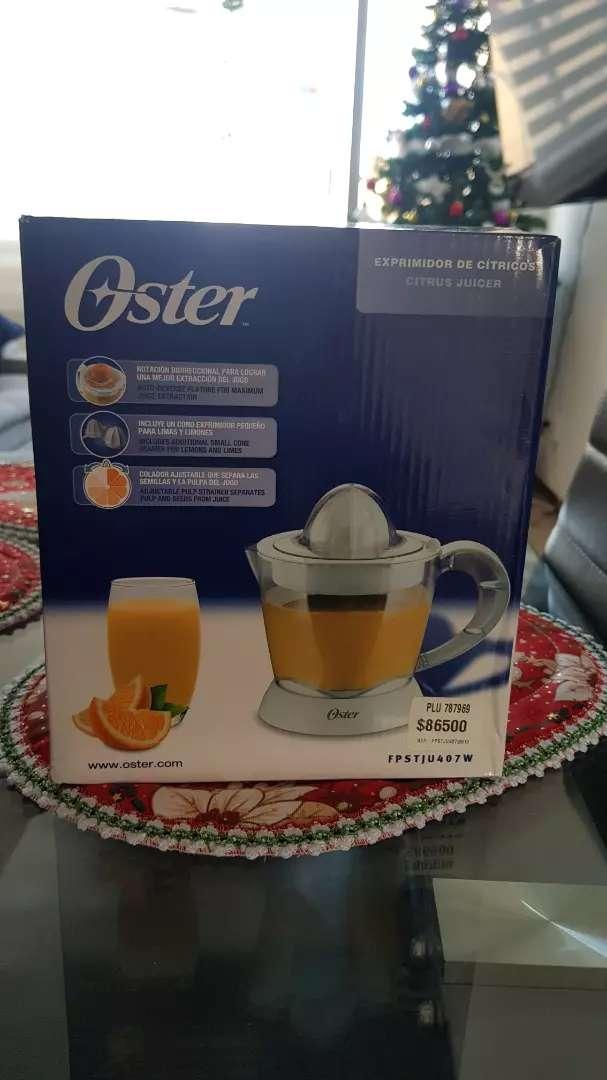 Exprimidora de Cítricos Oster 0
