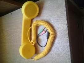 Accesorio celular teléfono vintage para usar como auricular