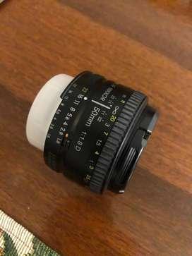 Lente nikon 50 mm perfecto