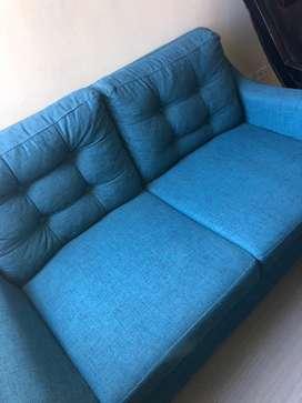 Sofa azul petroleo