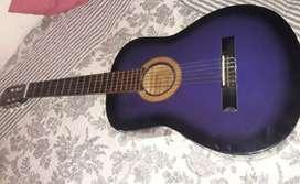 Guitarra morada y negra