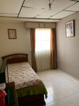 Habitación casa familiar con aire acondicionado
