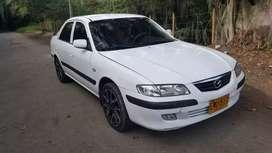Vendo o cambio Mazda Nuevo milenio