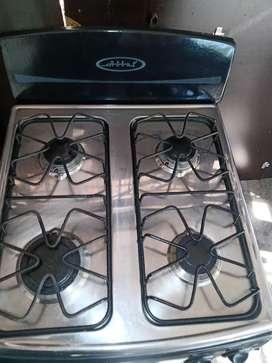 Se vende estufa 4 puestos ,marca abba ,con alacena incorporada.