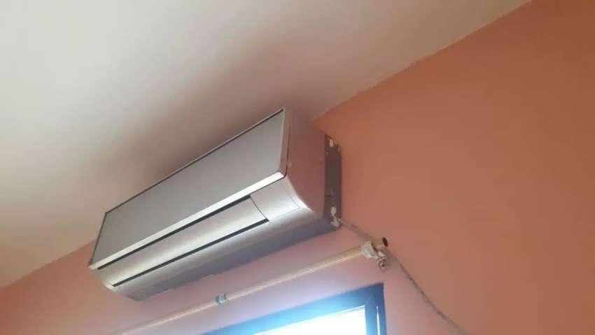 Vendo un aire acondicionado y cocina de Inducción 0