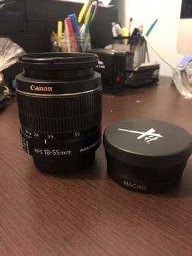 Lente de cámara Canon 18-55mm, junto a un lente macro para canon.