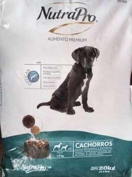 Nutrapro Cachorros razas medianas y grandes. Por libras. $1,35 la libra.