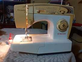 Vendo maquina de coser singer florencia 68