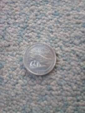 Moneda en buen estado de un quarte de dollar