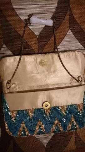 carteras , sobres y clutch importados de india