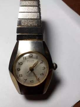 Vendo cambio permuto reloj  para dama MULCO  suizo  de  cuerda