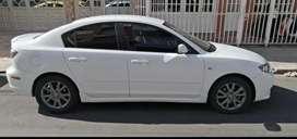 Mazda 3 sedan 2010 blanco en muy buen estado