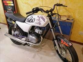 Vendo moto Ax100 pasada a 115