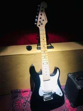 Guitarra para niños con amplificador