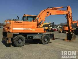Excavadora llantas  Doosan DX210W  Import