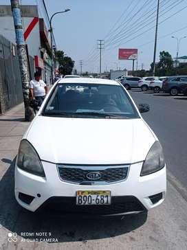 Kia rio 2010 permiso de taxi
