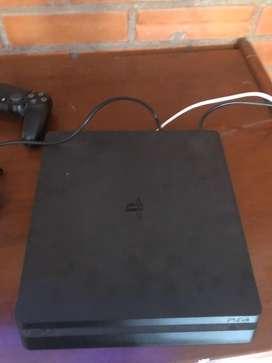 Playstation 4 slim con dos controles, dos juegos fisicos, 5 juegos digitales