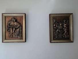 Cuadros tallados en madera.