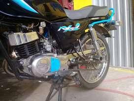 Motocicleta AX 100 2